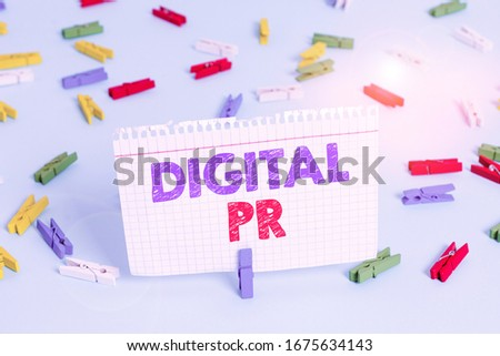 Writing note showing Digital Pr. Business photo showcasing marketing strategy used to increase their online presence Colored clothespin papers empty reminder blue floor officepin.