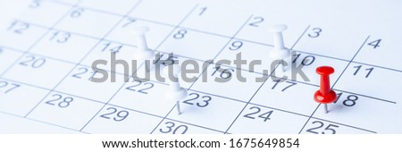 Tacks On Calendar Page/ 18th Royalty-Free Stock Photo #1675649854