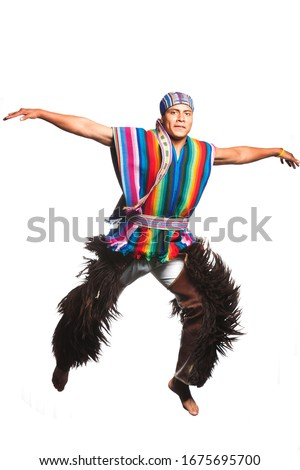 Ecuadorian Dancer Dressed Up In Formal Linen From The Andean Performing A Jump Llama Or Alpaca Pants Studio Shot Isolated On Colour