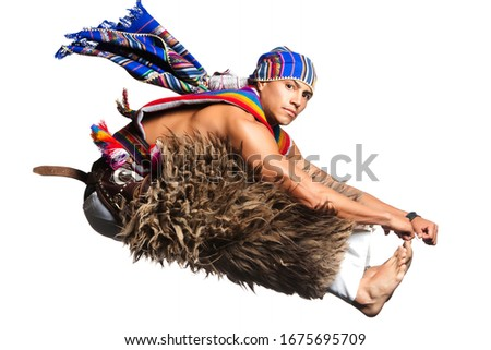 Ecuadorian Dancer Dressed Up In Popular Clothing From The Andes Performing A Jump Llama Or Alpaca Pants Studio Shot Isolated On White