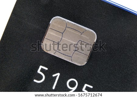 A microchip embedded on a credit card, where the encrypted data ensures secure payment and safe transaction. Macro closeup view. An electronic chip on an emv card for secure POS transaction.