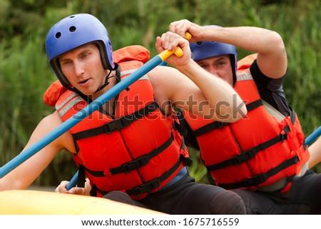 rafting jacket life wetsuit men man group kayak people partnership of young athletes training for whitewater rafting rafting jacket life wetsuit men man group kayak people float sport water white team #1675716559