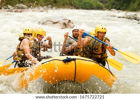 raft water white team sport activity whitewater extreme group rapids crowd of mixed tourist men and women with guided by professional pilot on whitewater creek rafting in ecuador raft water white team #1675722721