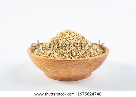 A wooden bowl of miscellaneous grains buckwheat on a white background	  Royalty-Free Stock Photo #1675824748
