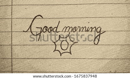 """Good morning"" on a notebook sheet"