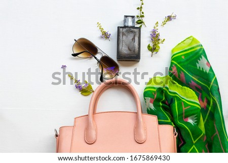 perfume, green scarf, sunglasses and pink hand bag accessories of lifestyle woman relax arrangement flat lay style on background white  #1675869430