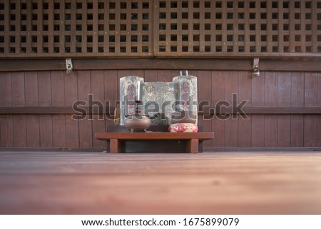 """A Small Shrine Altar With A Big Rock Behind With Engraved Kangi Letters, Says """"Isa Sakuro (person name), Donation For Opening Tomio-En Commemoration, Matsunaga (person name)"""" In Japanese. #1675899079"""