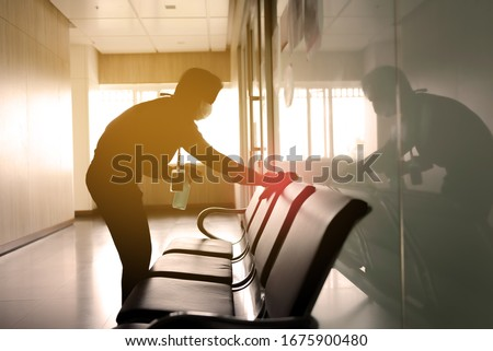blurred image of housekeeper cleaning service working at office. Blur image use for background. #1675900480