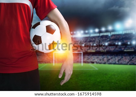 Soccer player with a soccer ball at the stadium