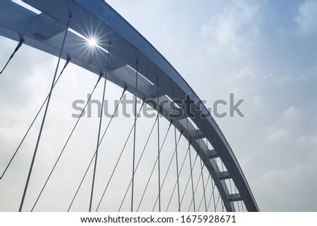 arch girder of suspension bridge closeup Royalty-Free Stock Photo #1675928671
