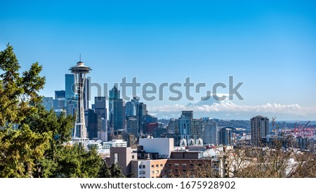 An image of Seattle with Mt Rainier in the background