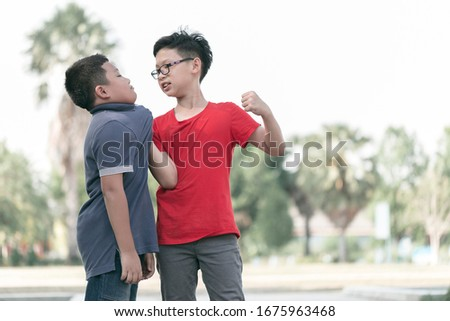 Asian Boy student getting bullied in school. Children bullying their classmate in playground.Violence, Banner and problem of bullying concept #1675963468