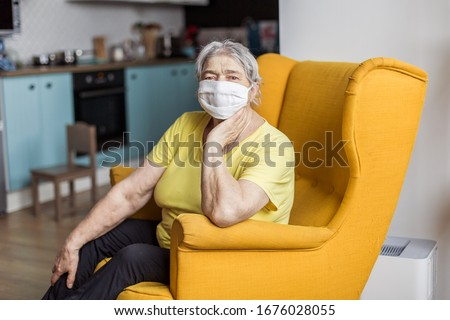 senior old woman in mask quarantine europe. Elderly at risk for coronavirus covid-19. Stay at home. Chinese virus pneumonia pandemic protection grandmother. danger of getting infected #1676028055