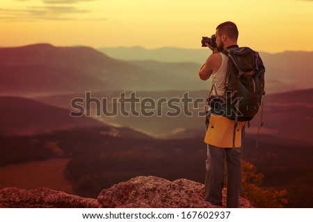 Nature photographer taking photos in the mountains