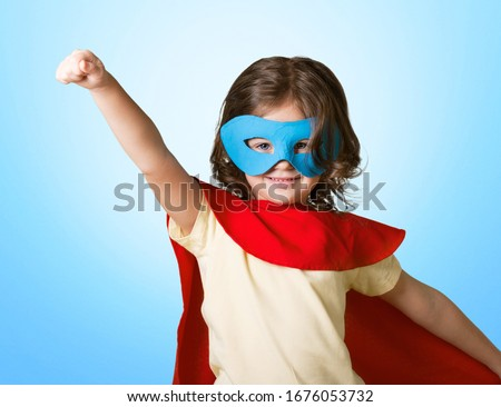 The little girl child in a superhero costume #1676053732