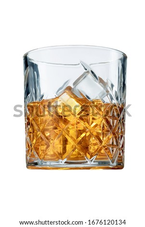 Old Fashioned Whiskey is contained in a crystal lowball glass and isolated on a table edge. The showy illustrative picture is made on the gray backdrop.