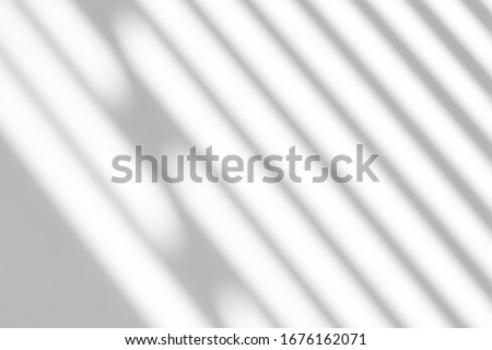 Blurred overlay effect for photo and mockups. Textured white wall with organic drop diagonal shadow of art deco stained glass window