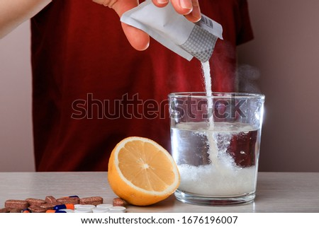 Woman dissolves medicine with soluble sachet in water. Soluble powder drug dissolved in water. headache, toothache