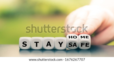 "Dice form the expression ""stay home, stay safe"". Royalty-Free Stock Photo #1676267707"