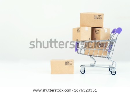 Paper boxes in a trolley on white background.Online shopping or ecommmerce concept
