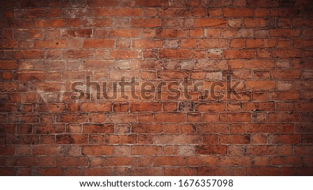 Red brick pattern. Old brick wall with cracks and scratches. Horizontal wide brickwall background. Distressed wall with broken bricks texture. Vintage house facade. #1676357098