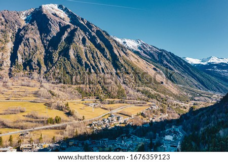 The village Palleusieux under a big mountain, in the Basin Pre-Saint-Didier, Aosta Valley at the time of corona virus outbreak, Italy #1676359123