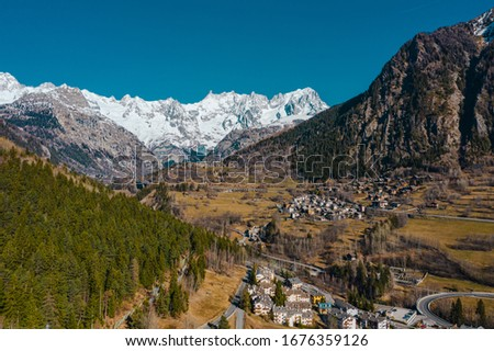 The village Palleusieux under a big mountain, in the Basin Pre-Saint-Didier, Aosta Valley at the time of corona virus outbreak, Italy #1676359126