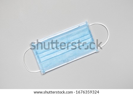 Surgical or medical face mask with blue colour. Concept of Corona virus protection. #1676359324