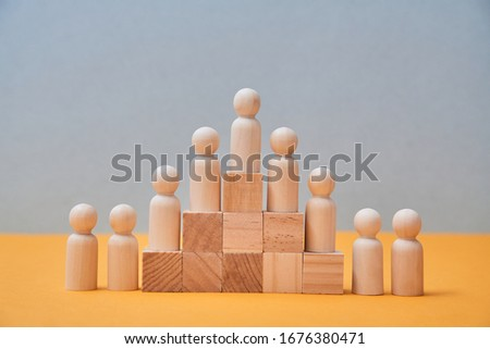Human resource, Talent management, Recruitment employee, Successful business team leader. Figures on wooden pyramid #1676380471