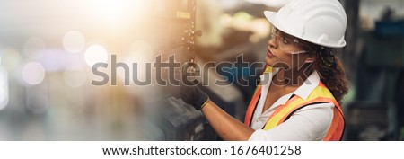 Professional engineer black women , worker, woman afican mechanical, maintenance, check in factory, warehouse Workshop for factory operators, engineering women training. Business factory. #1676401258