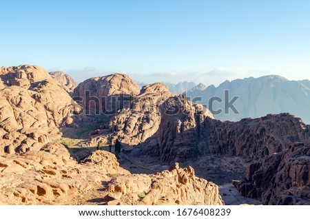 Mountain landscape at sunrise, view from Mount Moses, Sinai Peninsula, Egypt. #1676408239