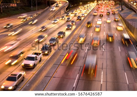 Traffic on Harbor Freeway, downtown Los Angeles, California, United States Royalty-Free Stock Photo #1676426587