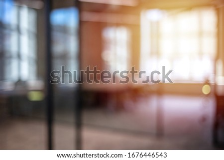 Blurred office interior space background. Abstract urban background with blurred buildings and street, shallow depth of focus. Blurred office interior space background