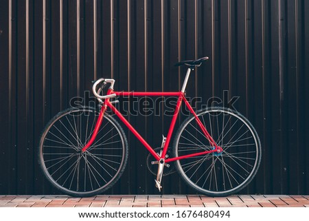 Fixed gear bicycle parked by the wall. Styled and toned photo for blog, music album pic