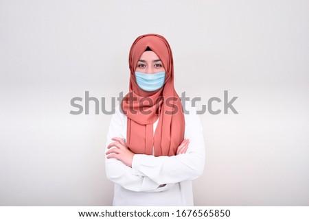 Muslim woman doctor wearing medical mask, muslim girl wearing mask for viral infection #1676565850