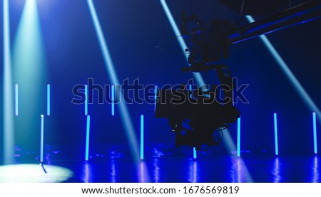 camera and crane on set Royalty-Free Stock Photo #1676569819