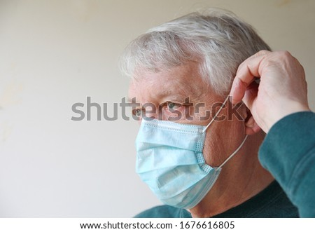 Older man with a medical face mask and room for text #1676616805