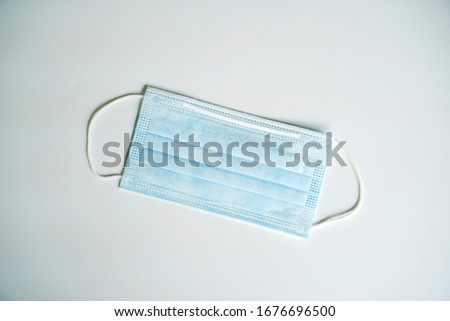 Surgical face mask. Medical mask for protect flu and virus. Face mask for cover nose and mouth with blue color on white background. #1676696500