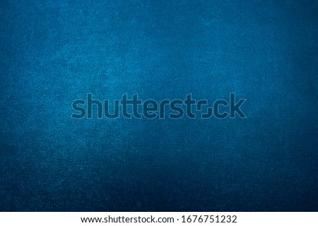Turquoise Blue Metallic textured background with a gradient.