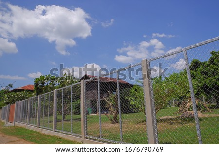 Chain Link Fence Barricade the house boundary. The boundary of the house is surrounded by a wire mesh fence.Protect the personal area, decorative wire mesh fence,industrial fence #1676790769