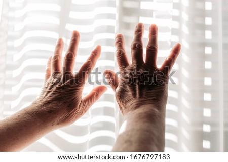 Elderly woman hands on the light. Rheumatism, arthritis #1676797183