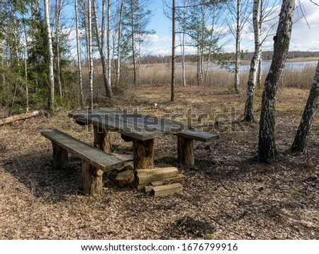picture with picnic spot by the lake, early spring