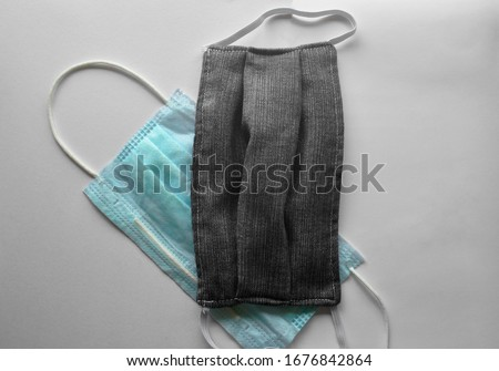 Facemasks on white background, concept for using medical equipments of the doctor at the hospital, office and people use to protect coronavirus, g-614, bacteria and germs as new, normal everyday. Royalty-Free Stock Photo #1676842864