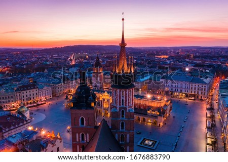 Basilica at Krakow old town city square at twilight drone view Royalty-Free Stock Photo #1676883790