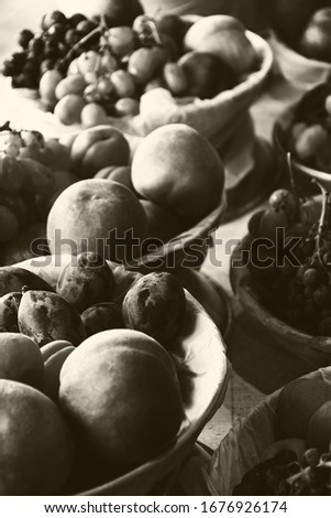 Sweet organic fresh fruit assortments for sale at local farmer market in France. Fruits background. Healthy eating, imperfection beauty, diversity and variety concepts. Sepia photo. #1676926174