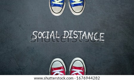 Social distance. two people keep spaced between each other for social distancing, increasing the physical space between people to avoid spreading illness during transmission of COVID-19 outbreak #1676944282