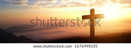 Silhouette of catholic cross at sunset background. Crucifixion of jesus christ panorama picture