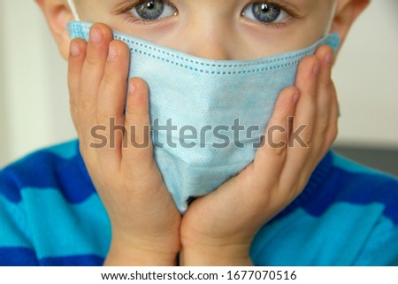 Kid using the medical face mask . Protection against corona virus. Sick child breathes through a protective mask #1677070516