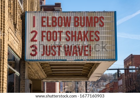 Movie cinema billboard with three rules to replace handshakes with elbow bumps, footshakes or just waving to friend during coronavirus epidemic #1677160903