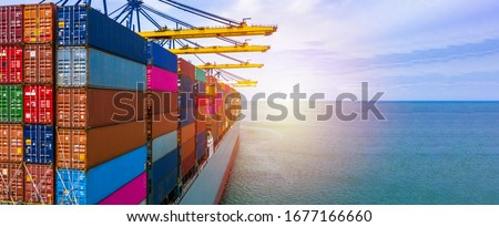 Container ship carrying container box in import export with quay crane, Global business cargo freight shipping commercial trade logistic and transportation oversea worldwide by container vessel. Royalty-Free Stock Photo #1677166660